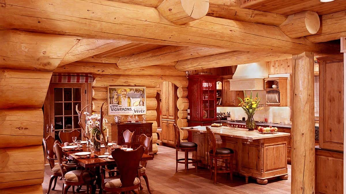 Kitchen and dinning room of a log home.