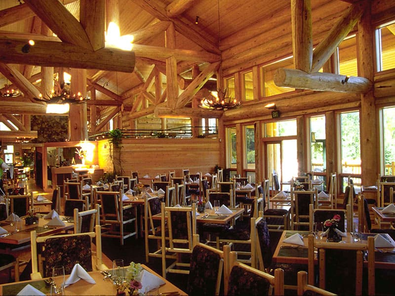 Dining room at Hidden Lakes Golf Resort. Interior is built with big natural logs.